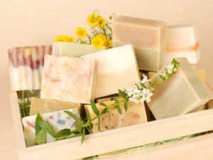 group of handmade soap in wooden box